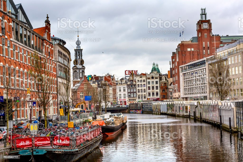 Boat Bicycle Parking Lot Munttoren Singel Canal Amsterdam Holland Netherlands stock photo