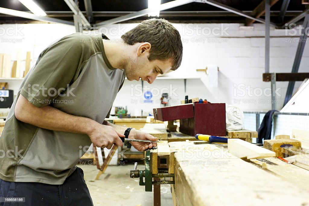 Boat builder using a chisel royalty-free stock photo