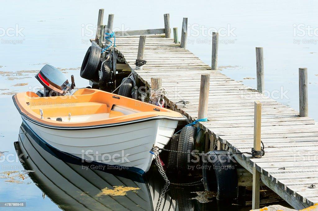 Boat by bridge stock photo