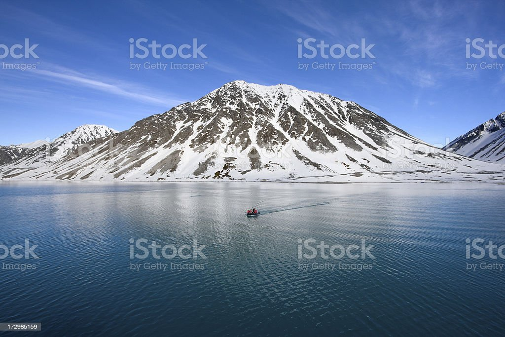 Boat by cold mountain stock photo