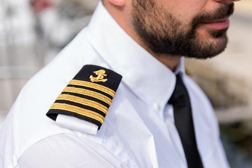 Boat captain with shoulder epaulette