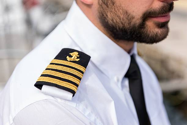 Boat captain with shoulder epaulette Horizontal color image of young boat captain, close-up of shoulder epaulette. cabin crew stock pictures, royalty-free photos & images