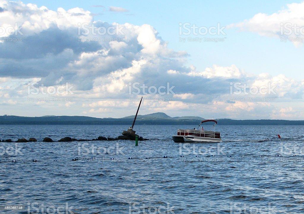 Boat Coming into Harbor stock photo