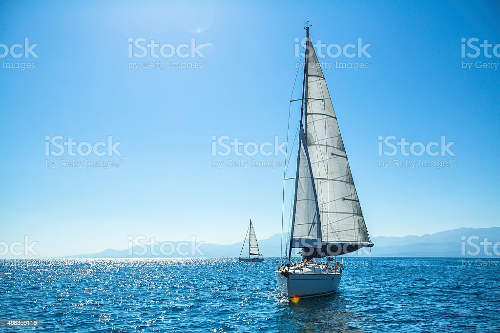 Boat competitor of sailing regatta in clear sunny weather. royalty-free stock photo