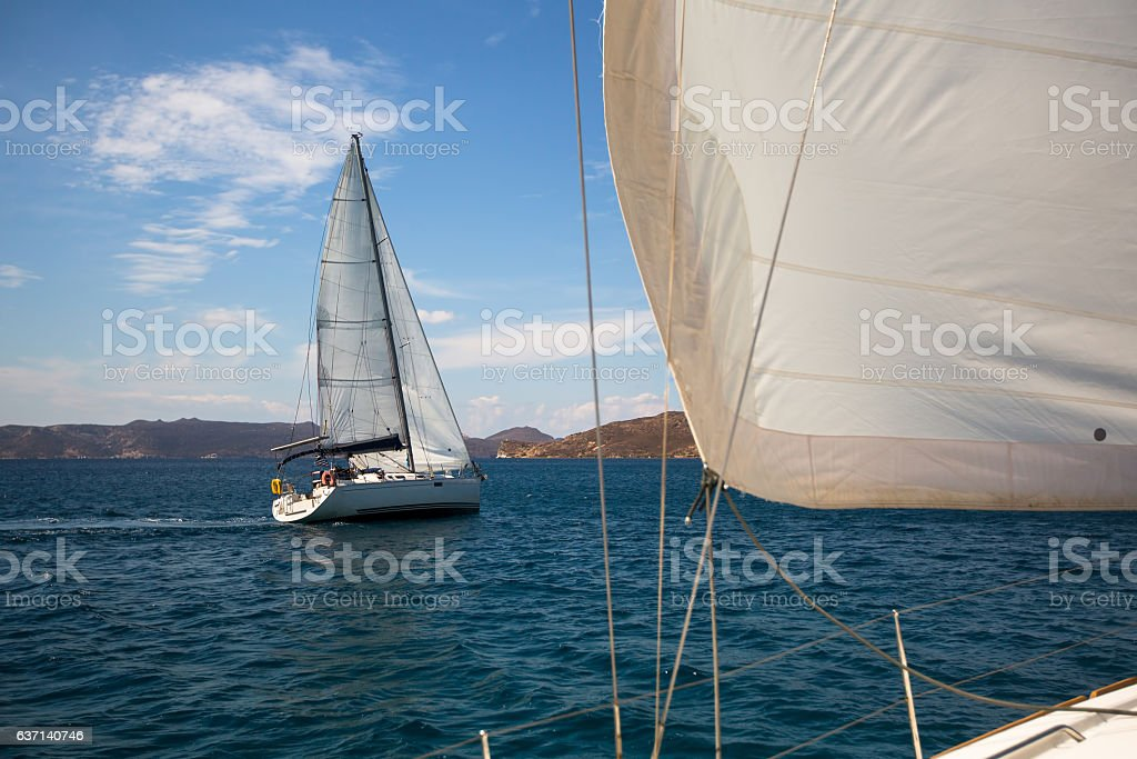 Boat competitor of sailing regatta in clear weather. stock photo