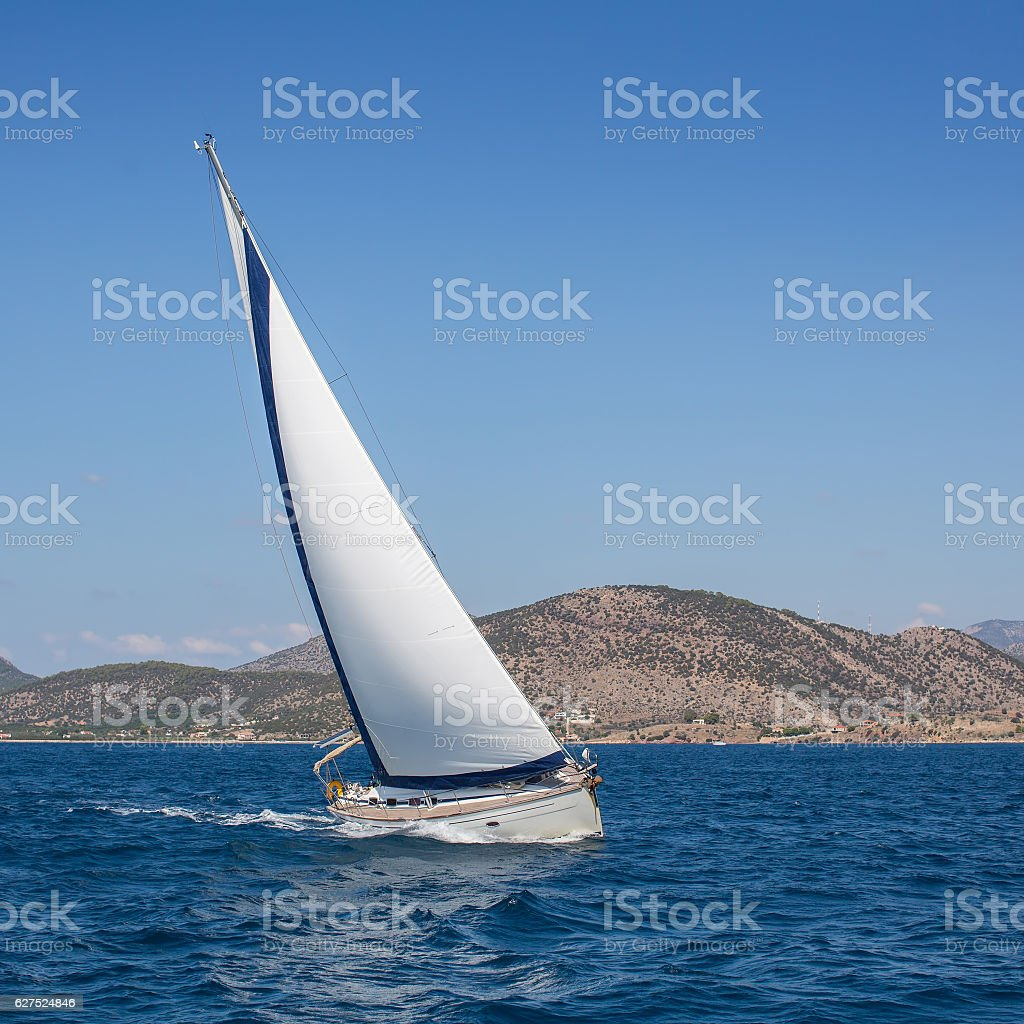 Boat competitor of sailing regatta. Yachting. stock photo