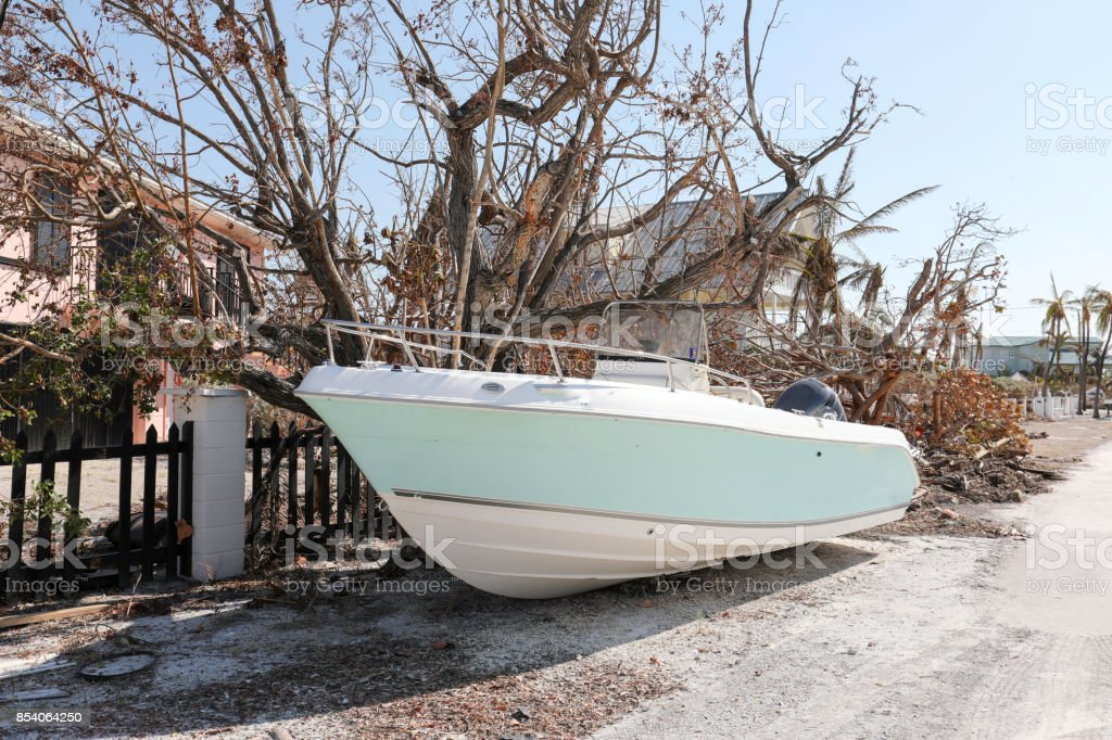 Boat crashed against fence due to hurricane in Florida Keys stock photo