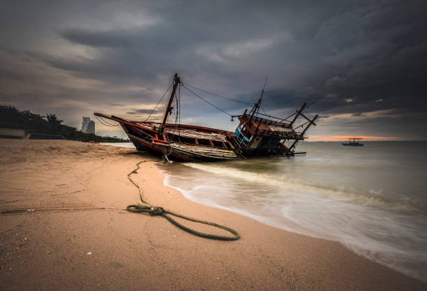 boat crashes in the sea - shipwreck stock pictures, royalty-free photos & images