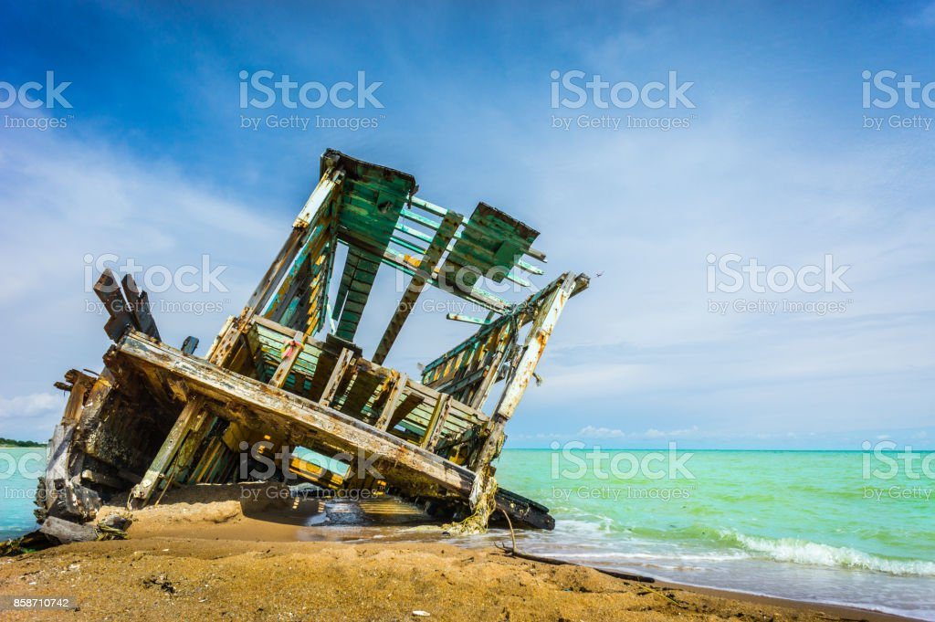Boat crashes in the sea stock photo