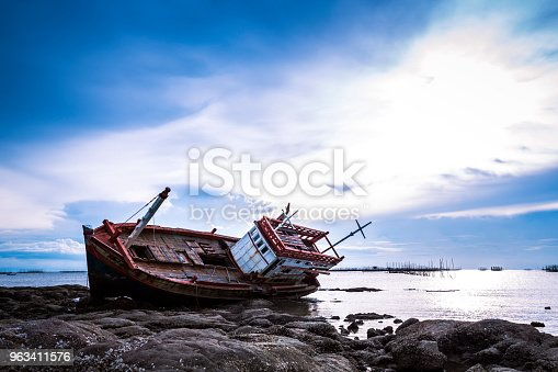 Boat crashes in the sea,Thailand. An old shipwreck on beach. Shipwreck in Ang Sila, Chonburi, Thailand.