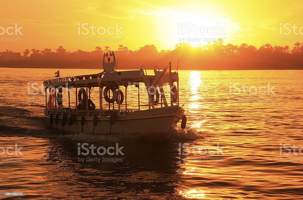 Boat cruising the Nile river at sunset, Luxor royalty-free stock photo