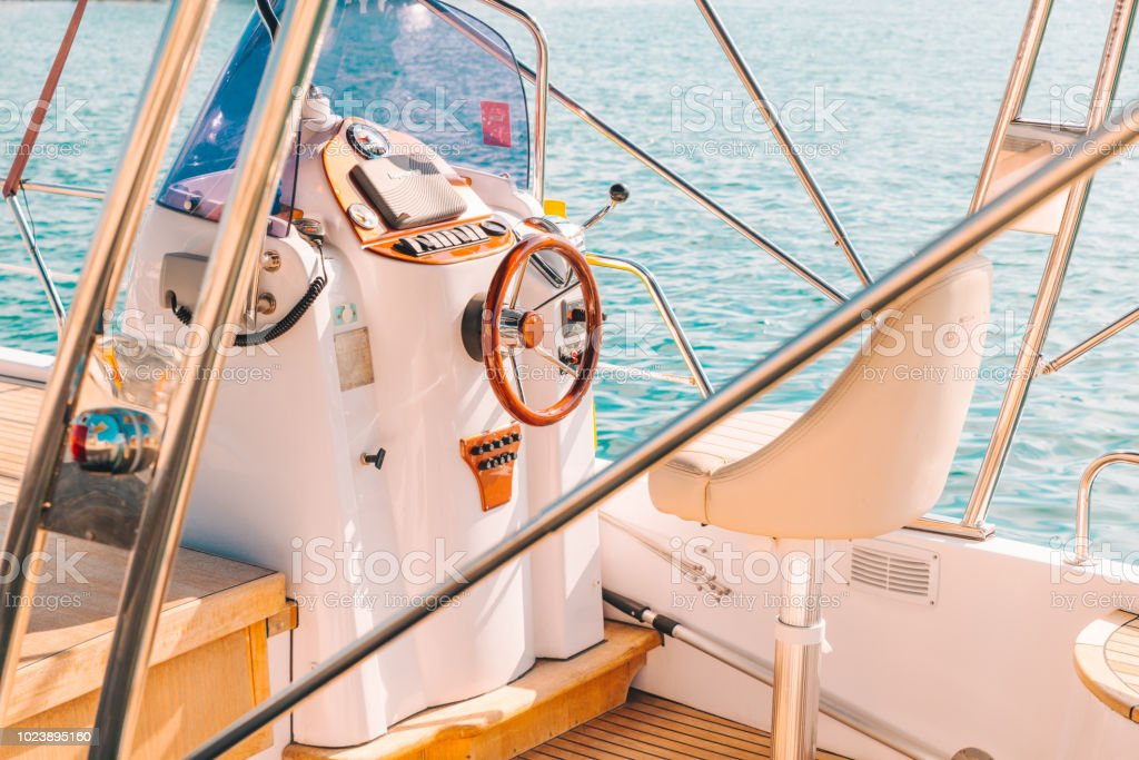 Boat Deck With Steering Wheel Close Up Stock Photo - Download Image