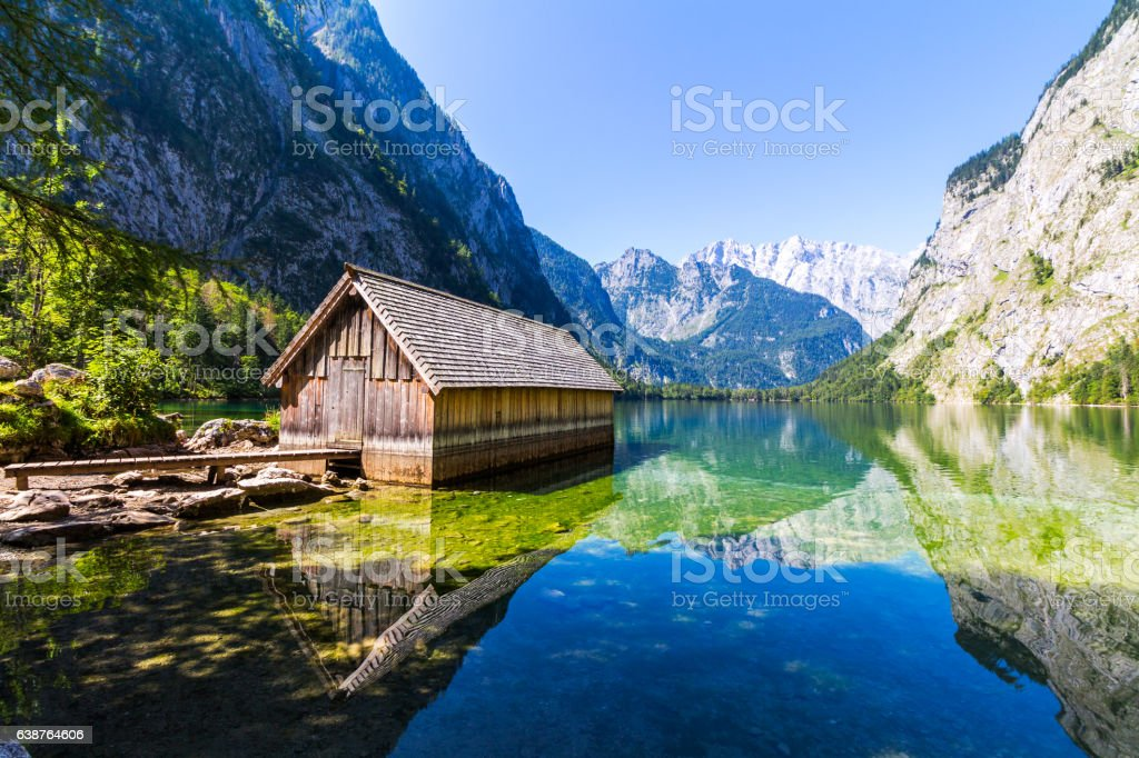Boat dock hangar on Obersee mountain lake in Alps. Bavaria stock photo
