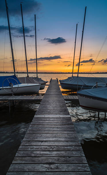 Boat Dock A boat dock at sunset in Madison, Wisconsin dane county stock pictures, royalty-free photos & images