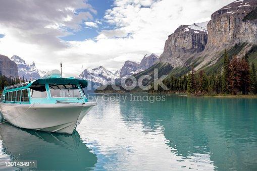 istock Boat docked at Spirit Island in Maligne Lake, Jasper National Park in Alberta, Canada 1301434911