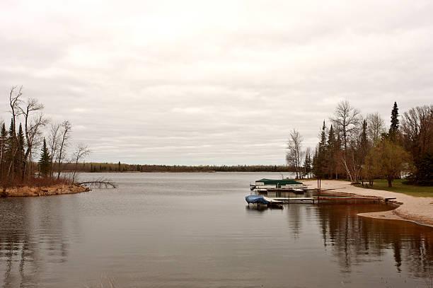 Boat docks on Northern Manitoba lake stock photo