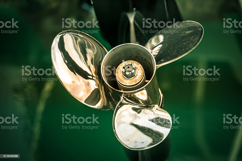 boat engine with propeller details shot stock photo