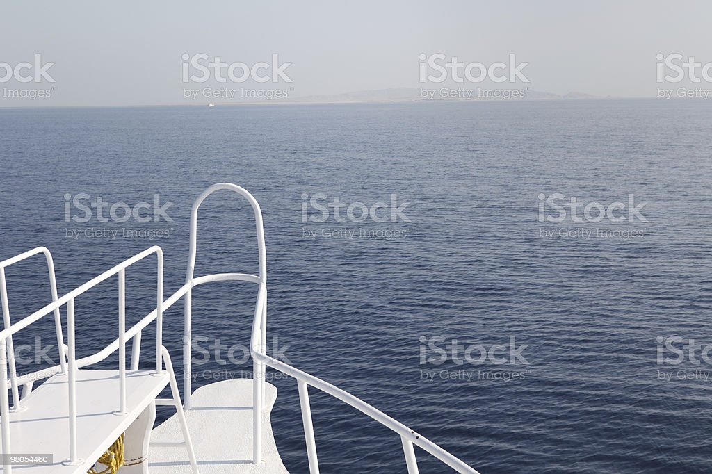 Boat front in flat water royalty-free stock photo