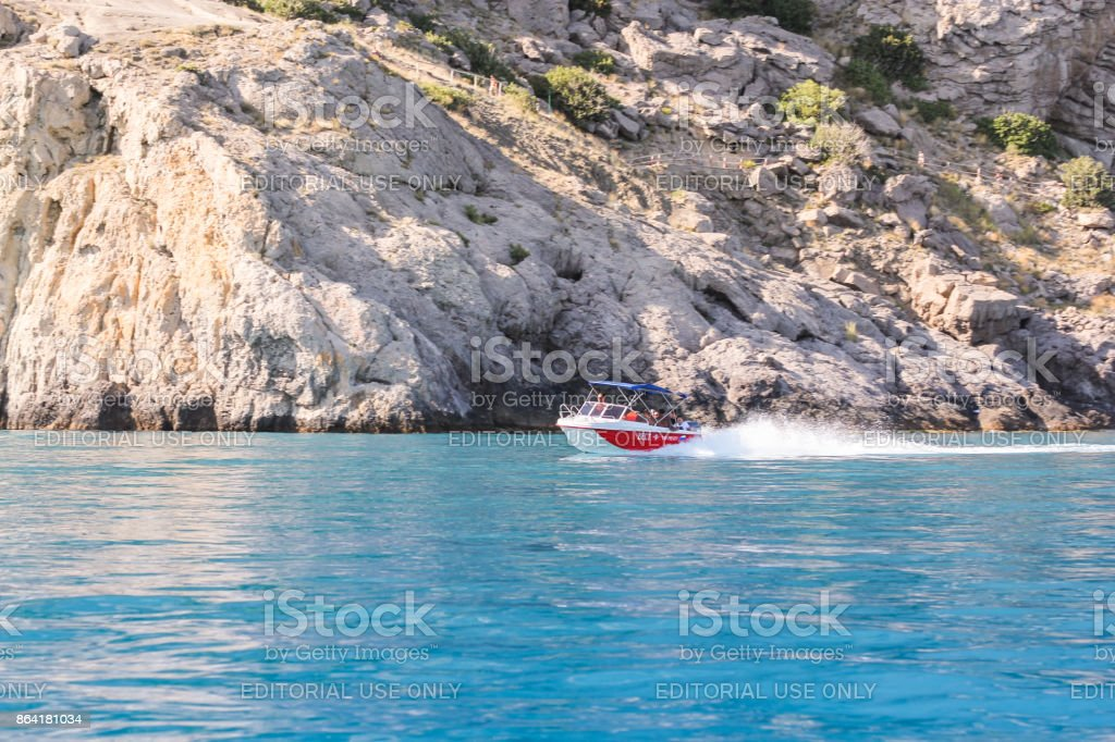 Boat going at speed along the shore. royalty-free stock photo
