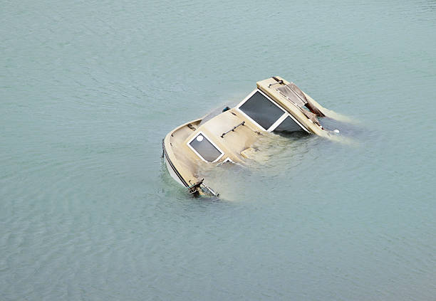 Boat going down Boat going down sunken stock pictures, royalty-free photos & images