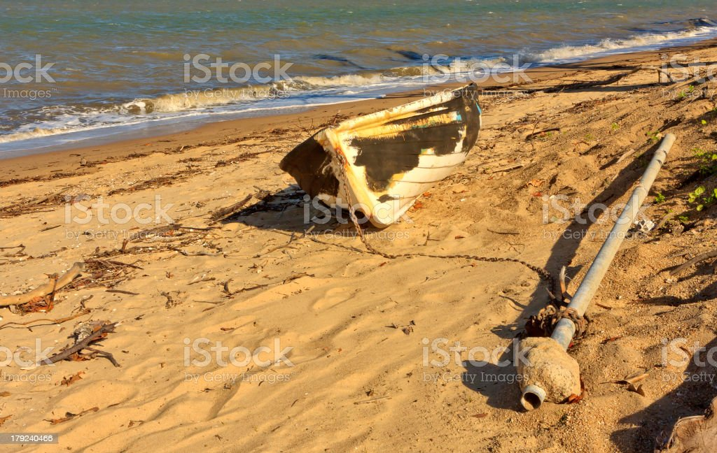Boat grounded after a cyclone royalty-free stock photo
