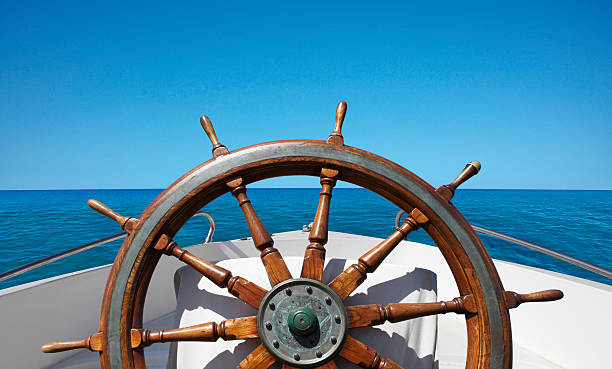 boat helm on the sea - roeren stockfoto's en -beelden