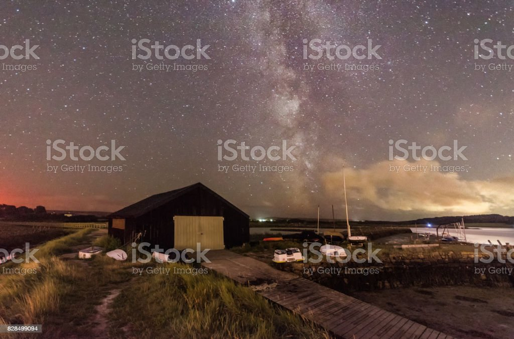 Boat house and milky way stock photo