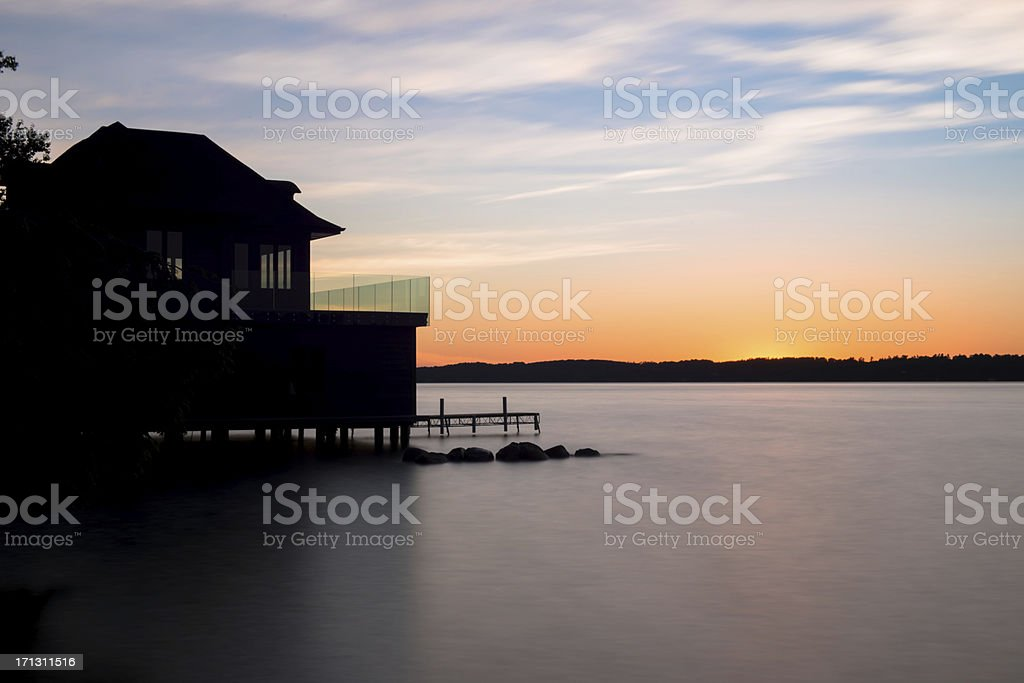 Boat house at sunset stock photo