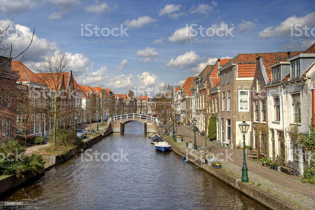 Boat in a canal in Leiden, Netherlands stock photo