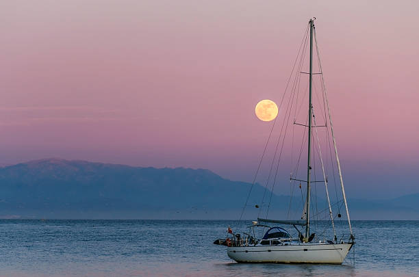 boat in a moonlight stock photo
