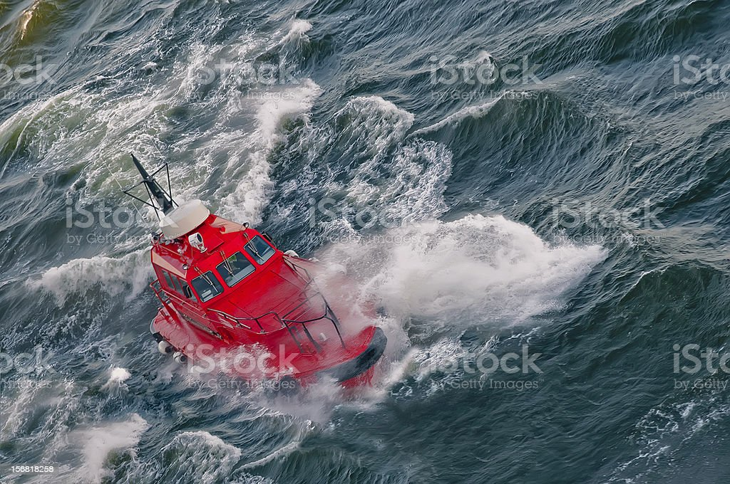 boat in a stormy sea royalty-free stock photo