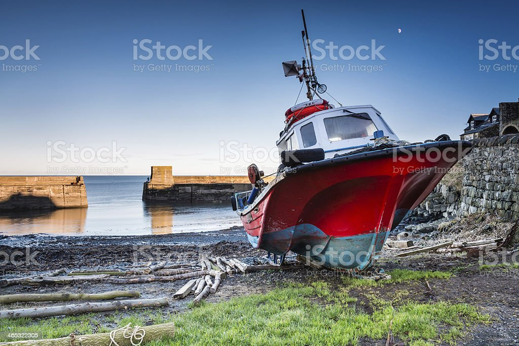 Boat in Craster Harbour stock photo
