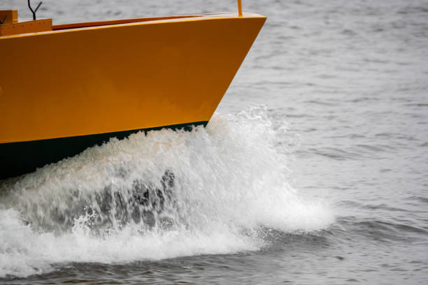 A boat in full speed over the water stock photo