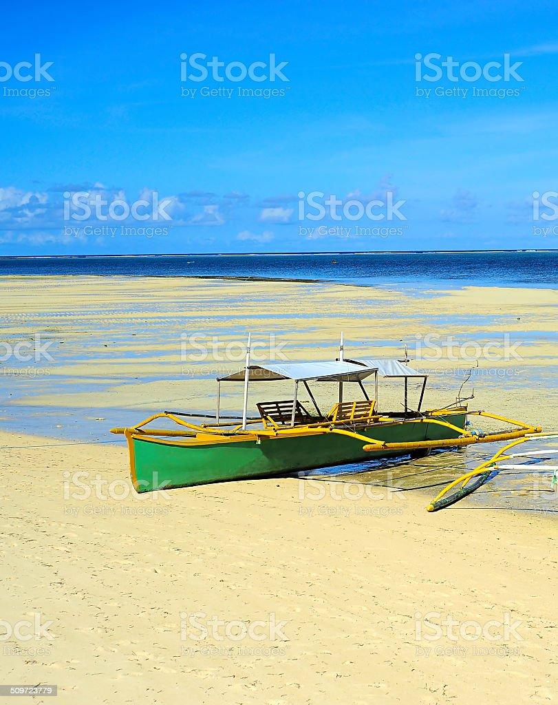Boat in Low tide stock photo