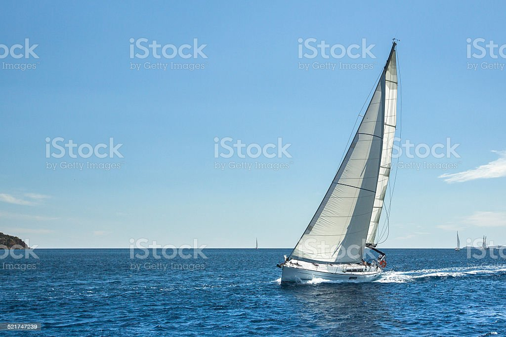 Boat in sailing regatta. luxury cruise yachts. stock photo