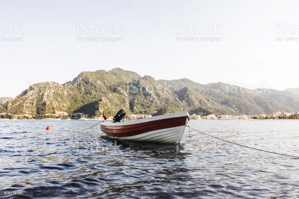 boat in sea with mountains stock photo