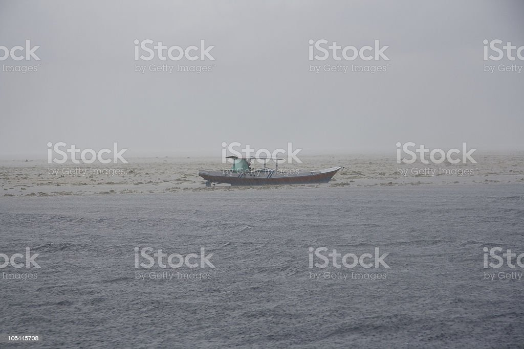 Boat in storm royalty-free stock photo