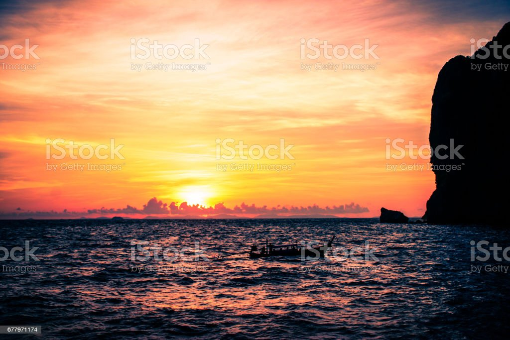 Boat in sunset close to Ko Phi Phi. royalty-free stock photo