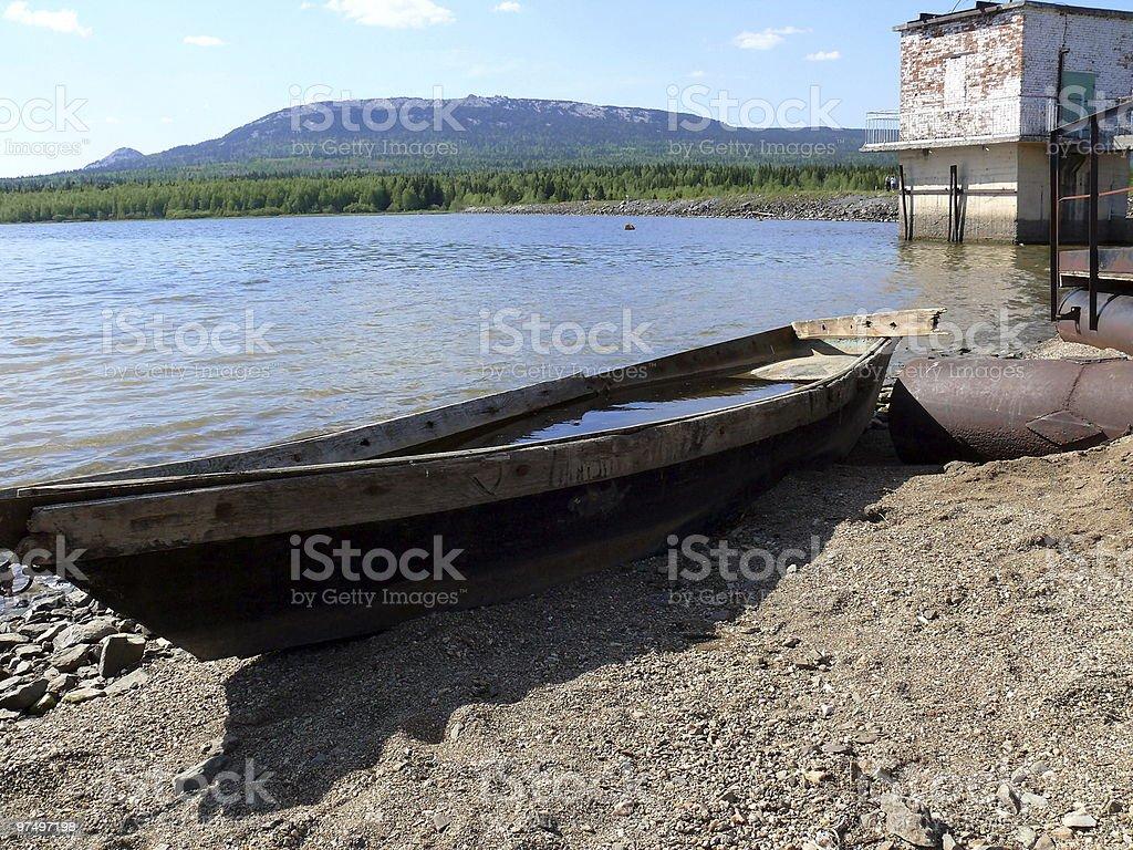 Boat in the coast of Zyuratkul' Lake royalty-free stock photo