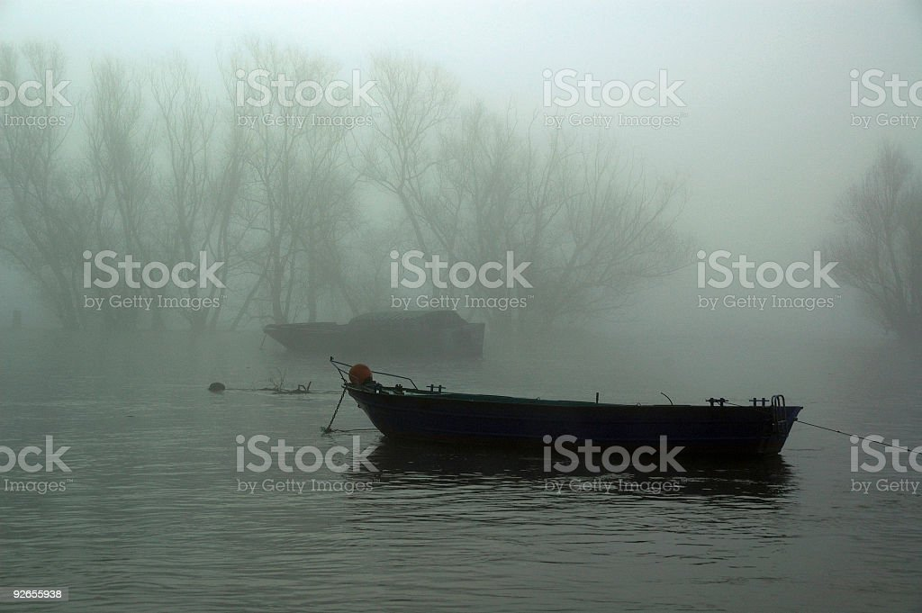 boat in the fog royalty-free stock photo