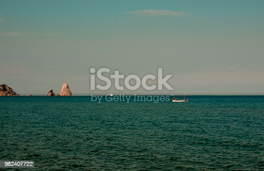 The blue sea with a boat in summer