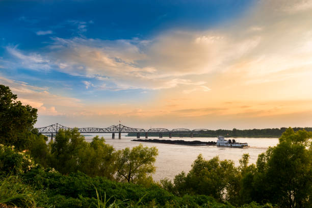 Boat in the Mississippi River near the Vicksburg Bridge in Vicksburg, Mississippi, USA. stock photo