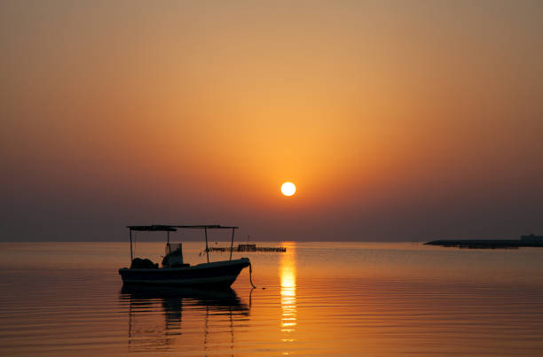 Boat in the morning hours  at Asker beach,  Bahrain stock photo