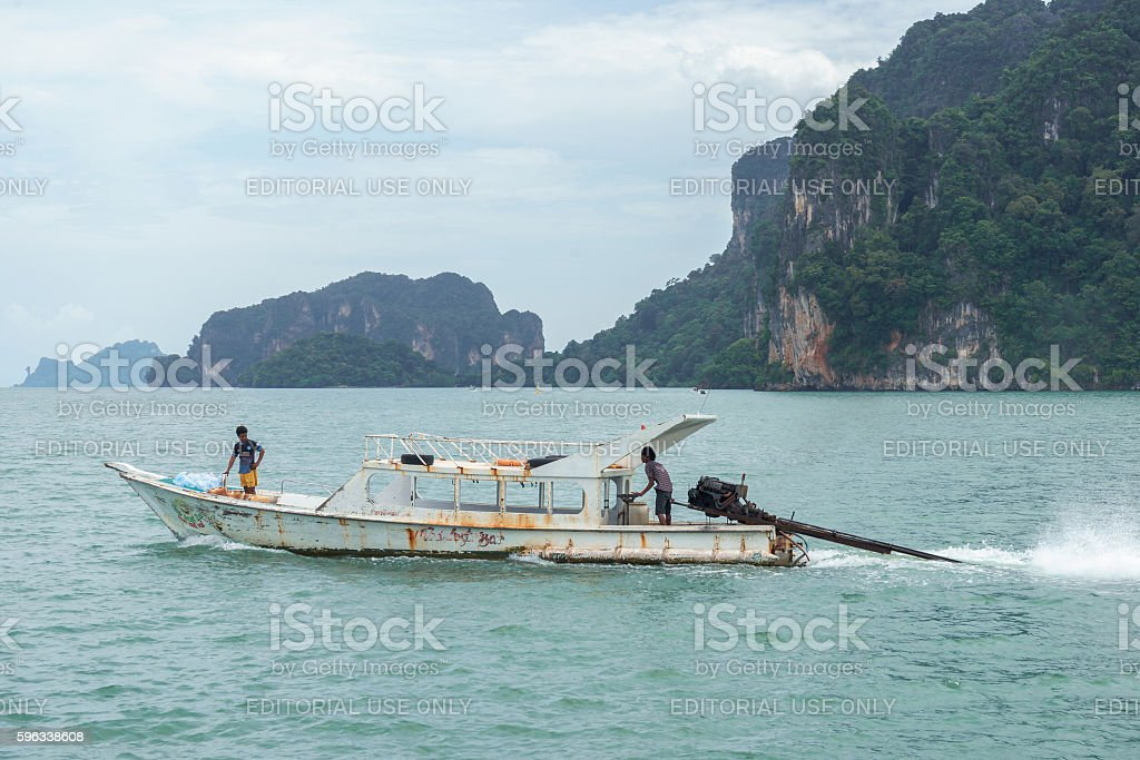 Boat in the sea with mountain background royalty-free stock photo