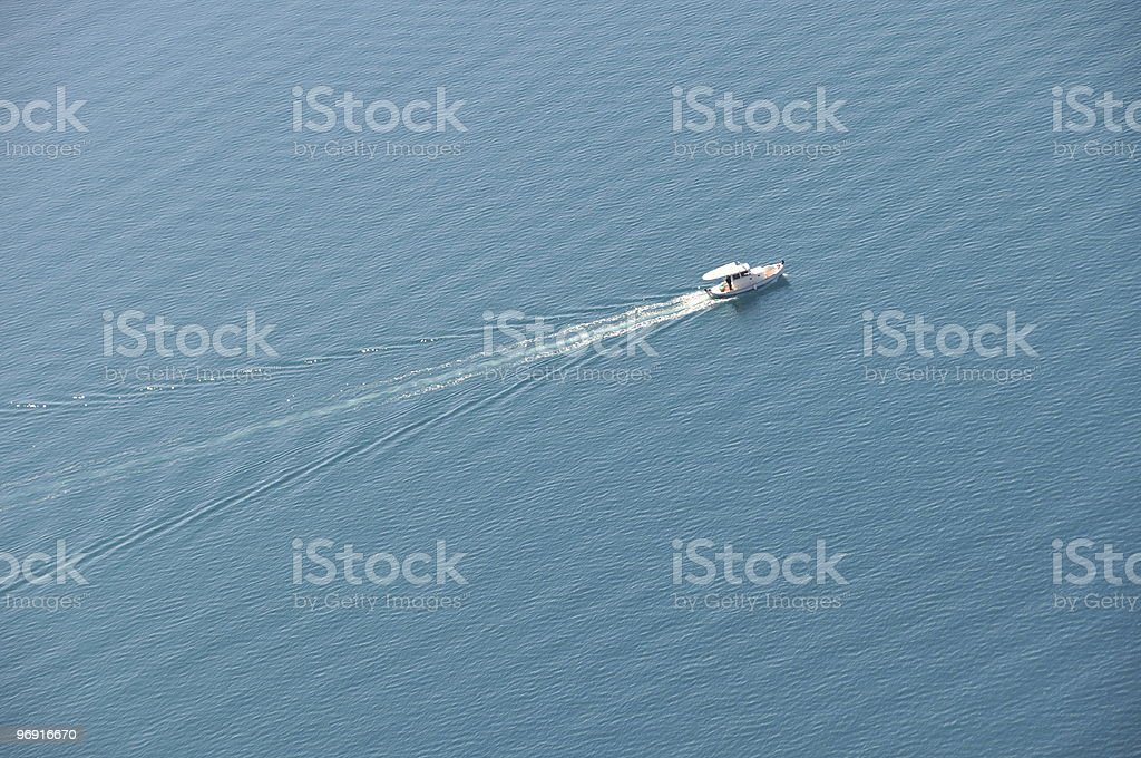 Boat in the water, leaving ripples royalty-free stock photo