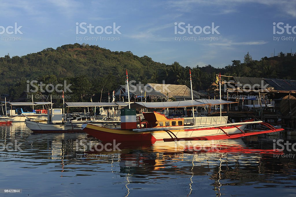 Boat in tropical bay royalty-free stock photo