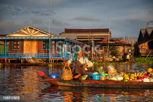 Cambodian market seller, Floating Village, Kampong Kleang, Siem Reap, Cambodia. Lots of detail, please look close up..