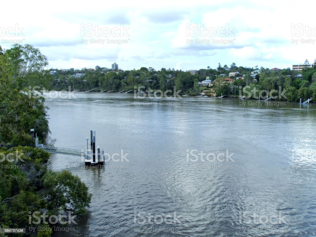Boat jetties and buildings on the Brisbane River stock photo