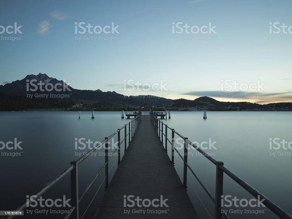 Boat jetty at dusk royalty-free stock photo