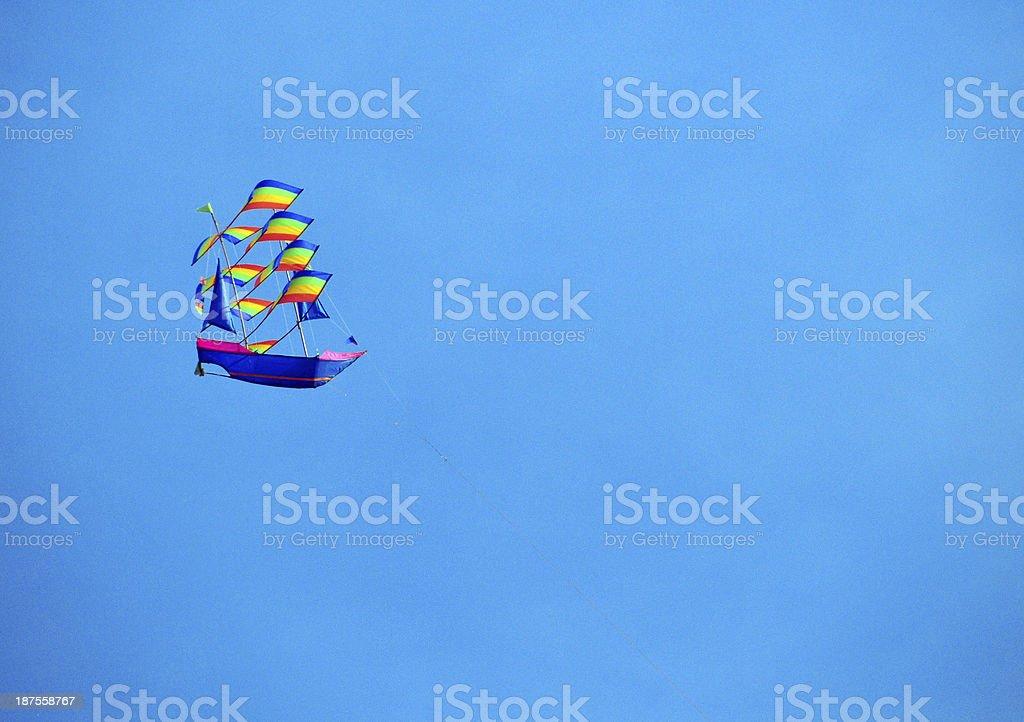 Boat Kite flying stock photo
